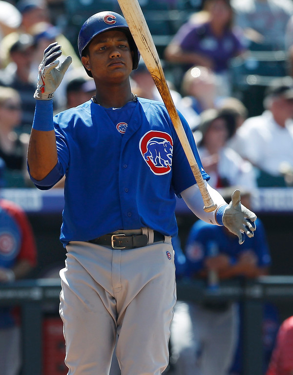 . Chicago Cubs\' Starlin Castro reacts after lining out with two runners on-base against the Colorado Rockies to end the top of the fifth inning of a baseball game in Denver, Sunday, July 21, 2013. (AP Photo/David Zalubowski)