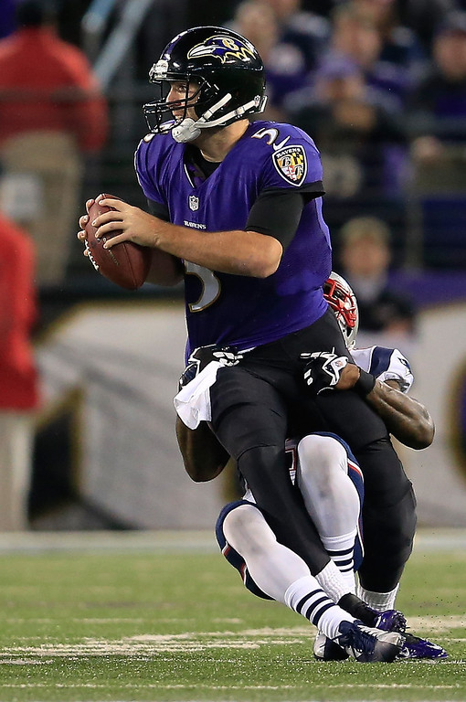 . Cornerback Kyle Arrington #25 of the New England Patriots sacks quarterback Joe Flacco #5 of the Baltimore Ravens during the first half at M&T Bank Stadium on December 22, 2013 in Baltimore, Maryland.  (Photo by Rob Carr/Getty Images)