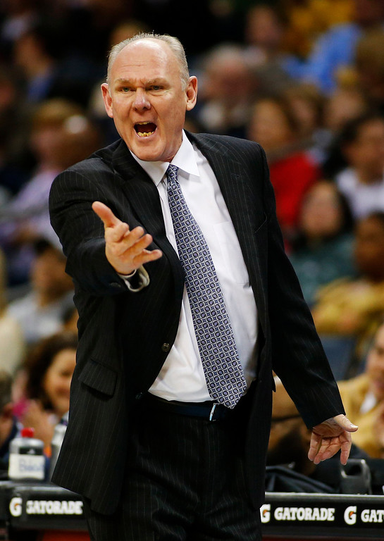 . Denver Nuggets head coach George Karl questions a call against the Charlotte Bobcats during the first half of their NBA basketball game in Charlotte, North Carolina February 23, 2013. REUTERS/Chris Keane