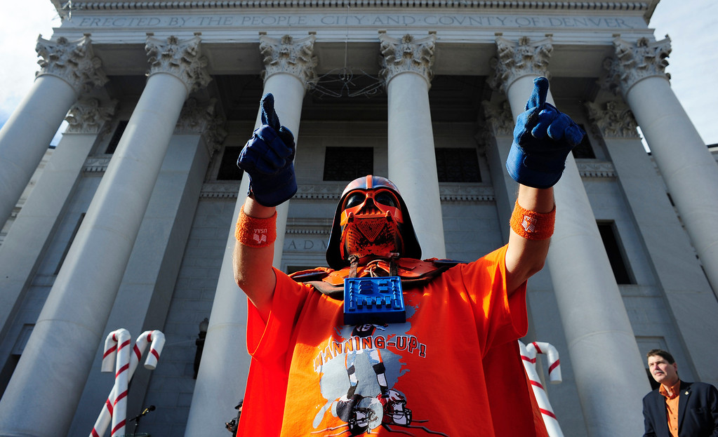 . A fan dressed with a Darth Vader helmet waves to the crowd during a rally to send off the Denver Broncos, at the City and County Building in Denver, Colorado, Sunday, January 26, 2014. The noon rally brought out scores of supporters and included an appearance by Governor John Hickenlooper and Denver Mayor Michael Hancock.  (Photo By Brenden Neville / Special to The Denver Post)