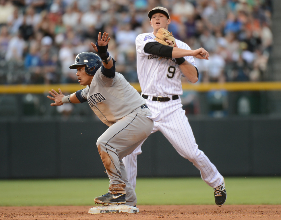 . Denver, CO. - June 08: Everth Cabrera of Diego Padres (2) steals 2nd base from DJ LeMahieu of Colorado Rockies (9) in the 3rd inning of the game at Coors Field. Denver, Colorado. June 8, 2013.  (Photo By Hyoung Chang/The Denver Post)