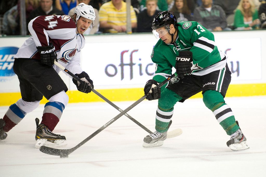 . DALLAS, TX - NOVEMBER 1:  Ray Whitney #13 of the Dallas Stars controls a lose puck against the Colorado Avalanche on November 1, 2013 at the American Airlines Center in Dallas, Texas.  (Photo by Cooper Neill/Getty Images)