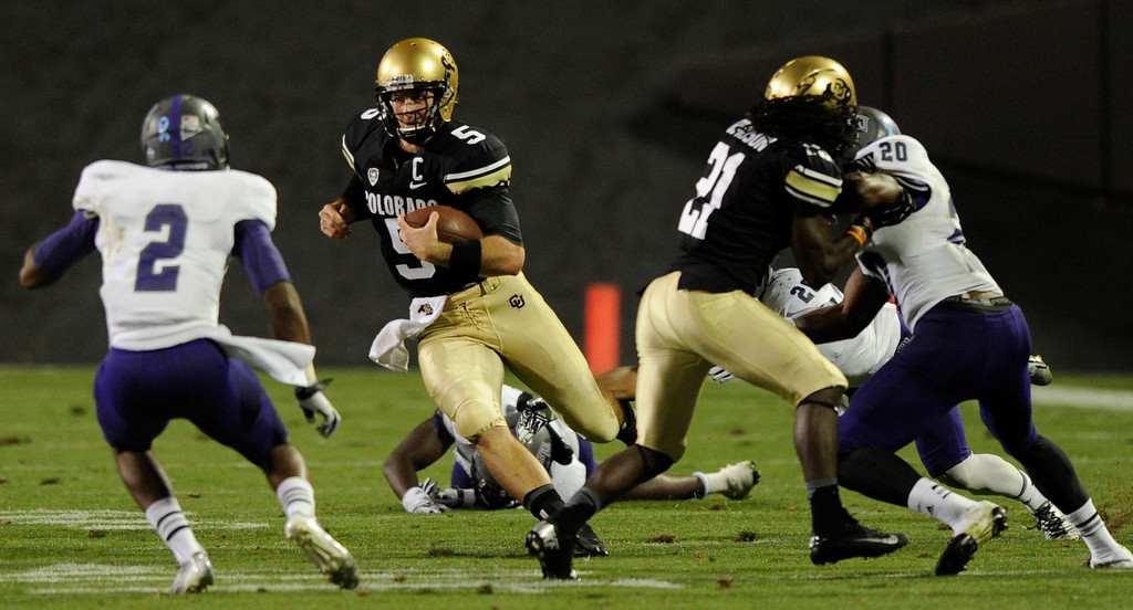 . BOULDER, CO. - SEPTEMBER 76: Buffs QB Connor Wood picked up a first down in the fourth quarter. The University of Colorado football team hosted Central Arkansas at Folsom Field Saturday night, September 7, 2013. Photo By Karl Gehring/The Denver Post