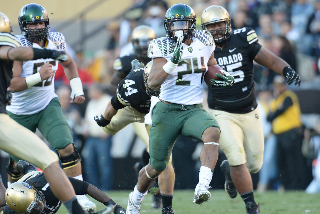 . RB Thomas Tyner of University of Oregon (24) controls the ball against University of Colorado defense in the 2nd quarter at Folsom Field. Boulder, Colorado. October 5, 2013. (Photo by Hyoung Chang/The Denver Post)