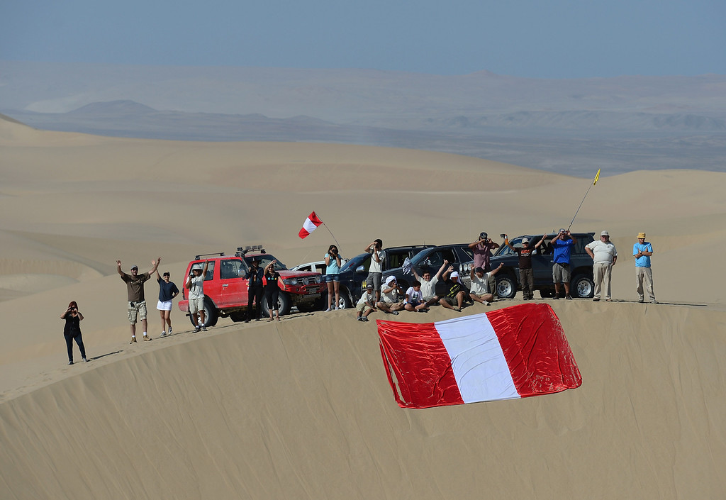 . PISCO, PERU - JANUARY 07:  Fans wait on the dunes during the stage from Pisco to Nazca on day three of the 2013 Dakar Rally on January 7, 2013 in Pisco, Peru.  (Photo by Shaun Botterill/Getty Images)