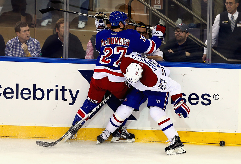 . Ryan McDonagh #27 of the New York Rangers battles for the puck against Max Pacioretty #67 of the Montreal Canadiens during Game Six of the Eastern Conference Final in the 2014 NHL Stanley Cup Playoffs at Madison Square Garden on May 29, 2014 in New York City.  (Photo by Elsa/Getty Images)