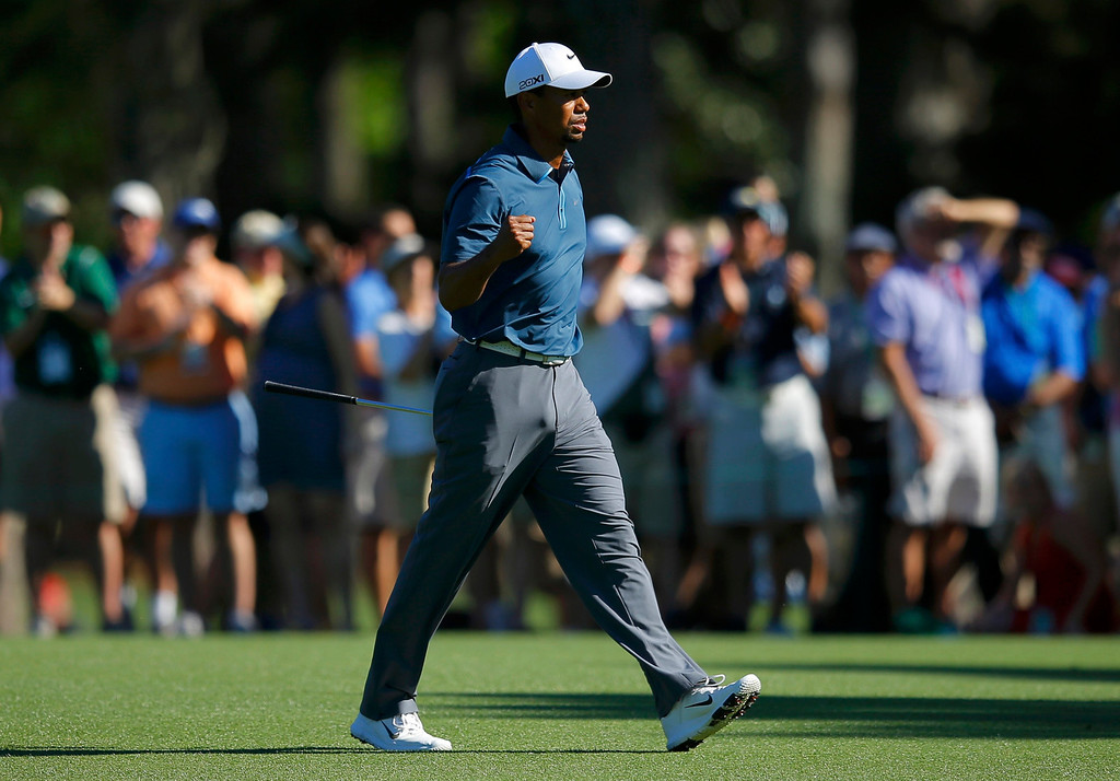 . Tiger Woods of the U.S. reacts to his approach shot to the 15th green during third round play in the 2013 Masters golf tournament at the Augusta National Golf Club in Augusta, Georgia, April 13, 2013.    REUTERS/Brian Snyder