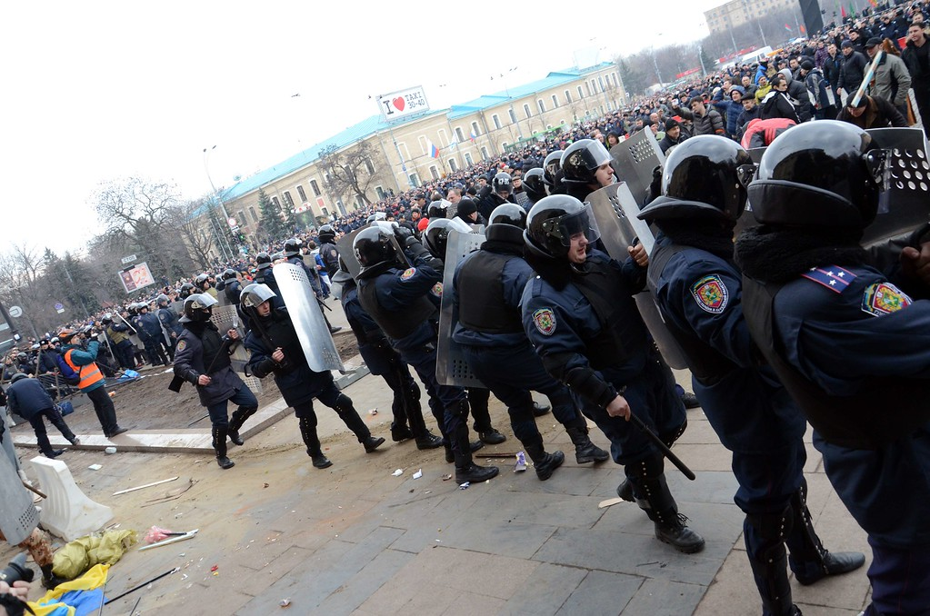 . Policemen try to stop pro-Russian activists storming a local government building in Kharkiv on March 1, 2014.  AFP PHOTO/ MIKHAIL KUCHNEV/AFP/Getty Images