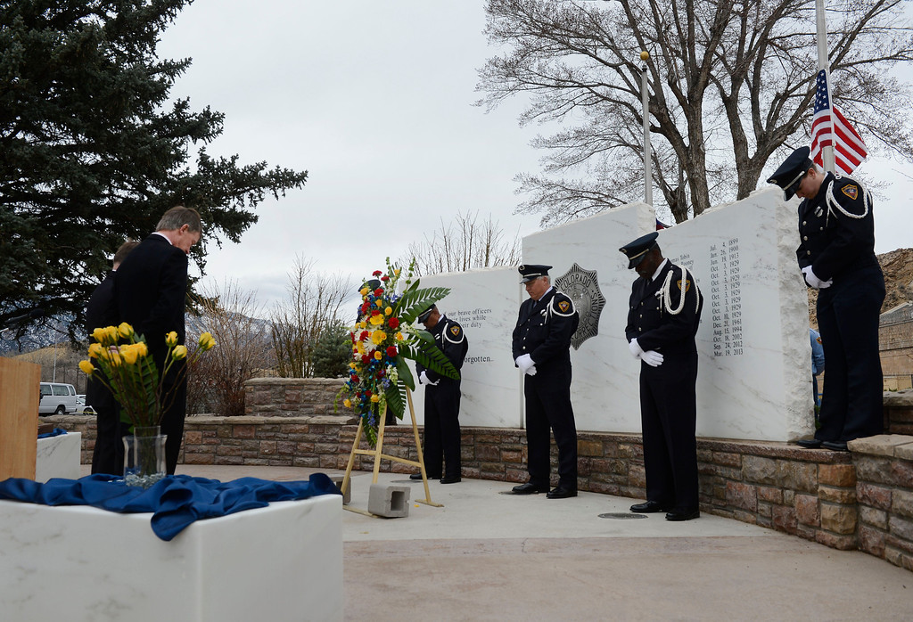. A moment of silence during the Colorado Department of Corrections Fallen Officer Memorial honoring the head of the DOC, Tom Clements, at the Territorial Correctional Facility park Saturday morning, March 15, 2014.  (Photo By Andy Cross / The Denver Post)