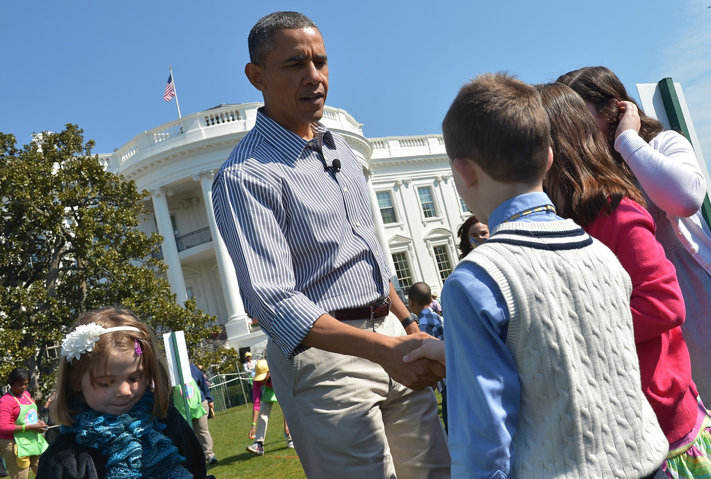 . US President Barack Obama greets children during the annual Easter Egg Roll on April 1, 2013 on the South Lawn of the White House in Washington, DC. AFP PHOTO/Mandel NGAN/AFP/Getty Images