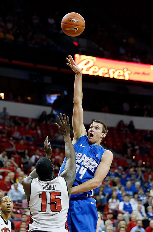. Air Force\'s Taylor Broekhuis shoots over UNLV\'s Anthony Bennett during the first half of a Mountain West Conference tournament NCAA college basketball game on Wednesday, March 13, 2013, in Las Vegas. (AP Photo/Isaac Brekken)