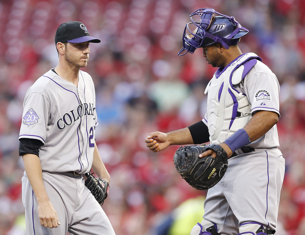 . Jon Garland #27 and Wilin Rosario #20 of the Colorado Rockies talk during the game against the Cincinnati Reds at Great American Ball Park on June 5, 2013 in Cincinnati, Ohio. (Photo by Joe Robbins/Getty Images)