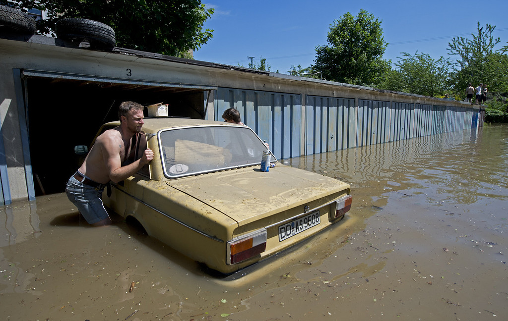 . Residents push a car out of a garage flooded by the river Elbe in Dresden, eastern Germany, on June 5, 2013.     AFP PHOTO / ROBERT T MICHAEL/AFP/Getty Images