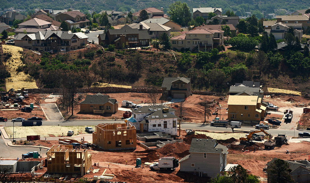 . Homes are being rebuilt in the Mountain Shadows neighborhood in Colorado Springs after the Waldo Canyon fire, June 20, 2013. (Photo By RJ Sangosti/The Denver Post)