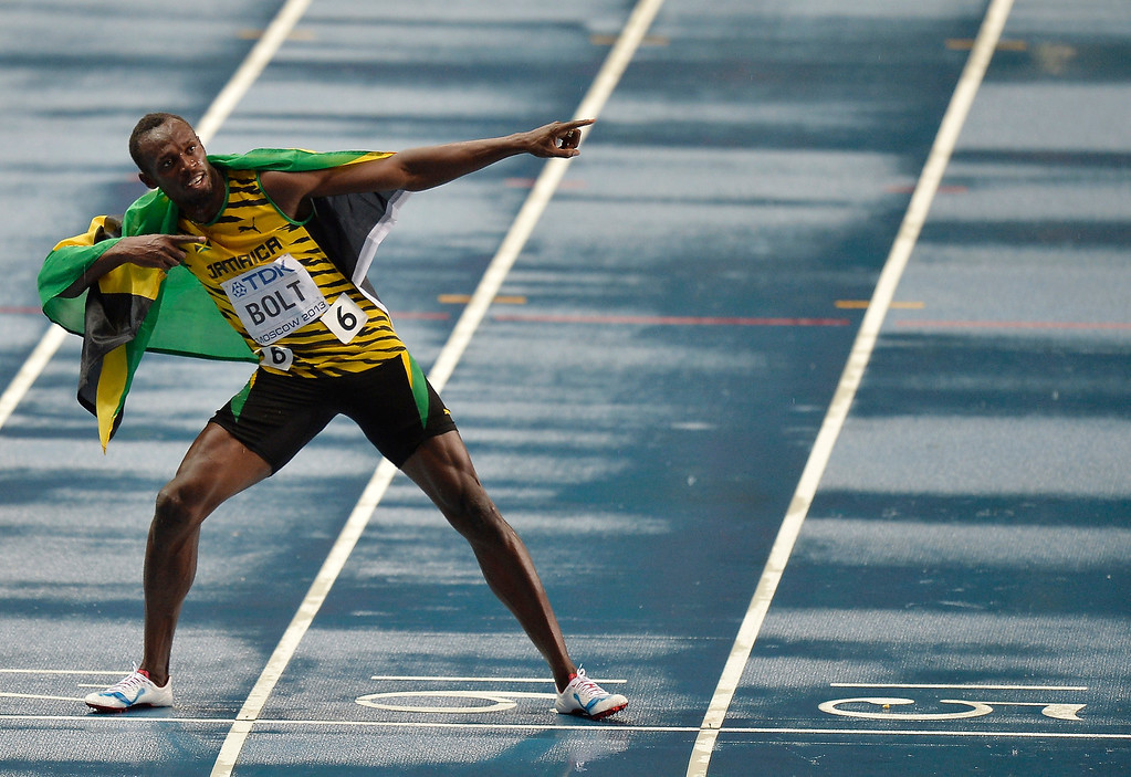 . Jamaica\'s Usain Bolt celebrates after winning gold in the Men\'s 100-meter final at the World Athletics Championships in the Luzhniki stadium in Moscow, Russia, Sunday, Aug. 11, 2013. (AP Photo/Martin Meissner)