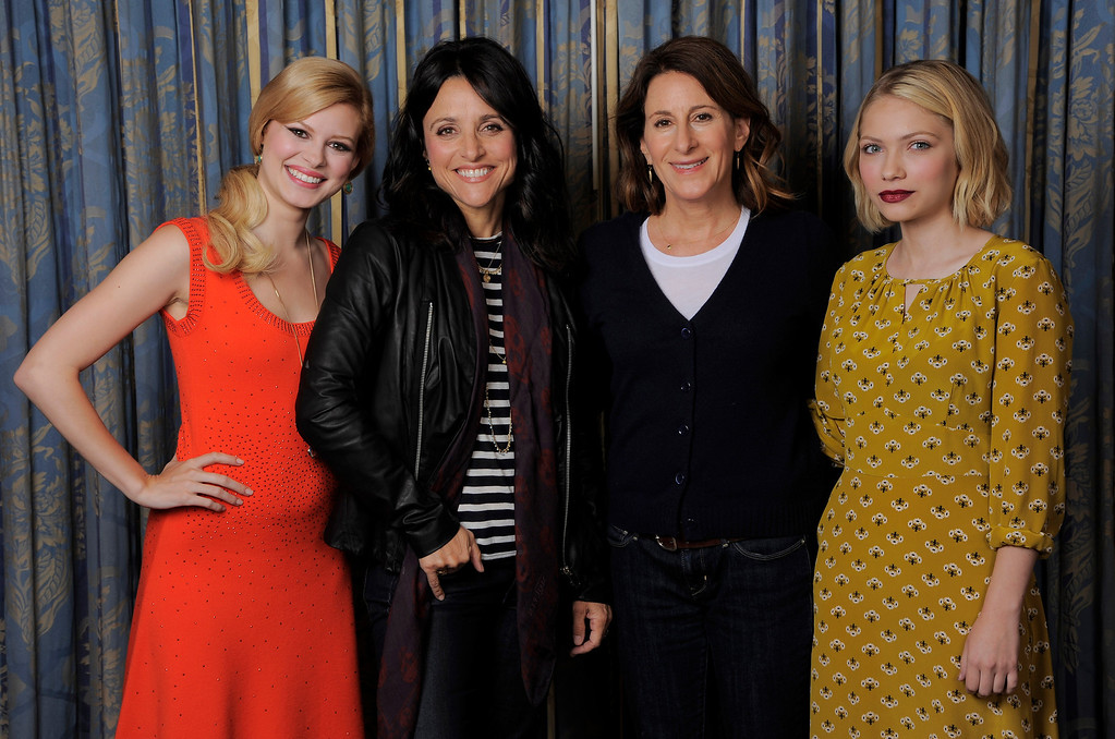 ". Writer-director Nicole Holofcener, second right,  of the film ""Enough Said,\"" poses with cast members, from left, Tracey Fairaway, Julia Louis-Dreyfus and Tavi Gevinson on day 4 of the 2013 Toronto International Film Festival on Sunday, Sept. 8, 2013 in Toronto. (Photo by Chris Pizzello/Invision/AP)"