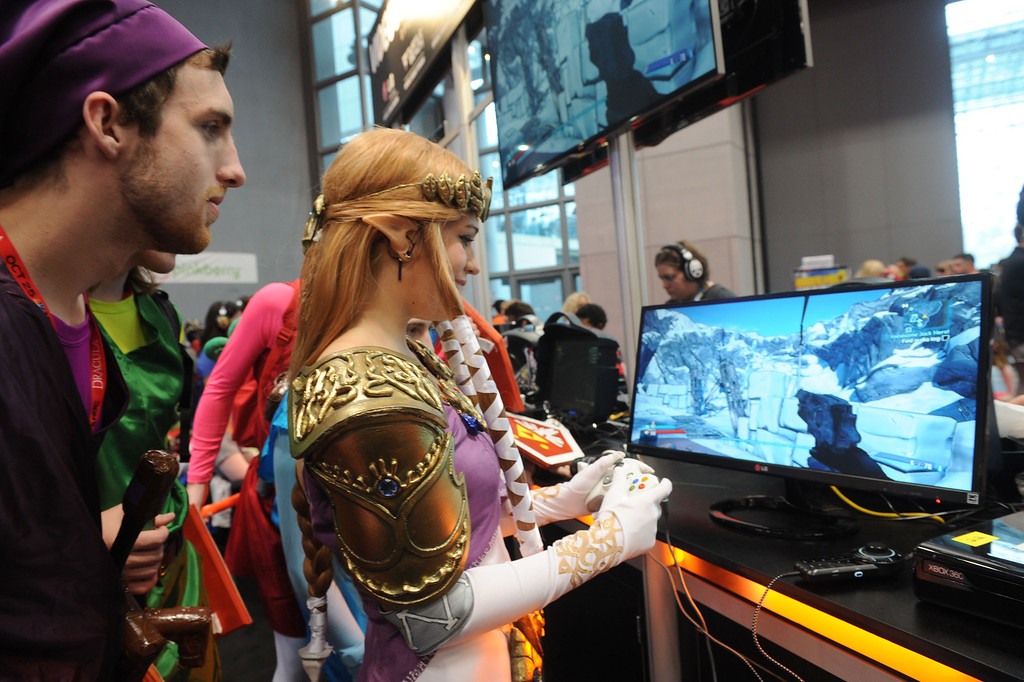 . Extreme gaming enthusiasts at New York Comic Con experience some of the hottest new titles on the 21:9 aspect5 ratio ìUltraWideî monitors from LG Electronics ñ at �the showís Free Play Zone, Friday, Oct. 11, 2013.   (Photo by Diane Bondareff/Invision for LG/AP Images)