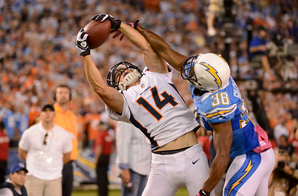 . Denver Broncos wide receiver Brandon Stokley (14) goes up and hauls in a touchdown pass from San Diego Chargers cornerback Marcus Gilchrist (38) in the fourth quarter Monday, October 15, 2012 at Qualcomm Stadium during Monday Night Football.  Photo by John Leyba, The Denver Post