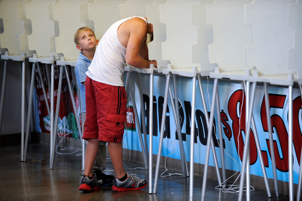 . PUEBLO, CO. - SEPTEMBER 10: Joseph Thiel, age 8, waited while his father Pete cast his ballot in the recall election at the Colorado State Fairgrounds Tuesday afternoon, September 10, 2013. State Senator Angelo Giron faces a recall in District 3. Photo By Karl Gehring/The Denver Post