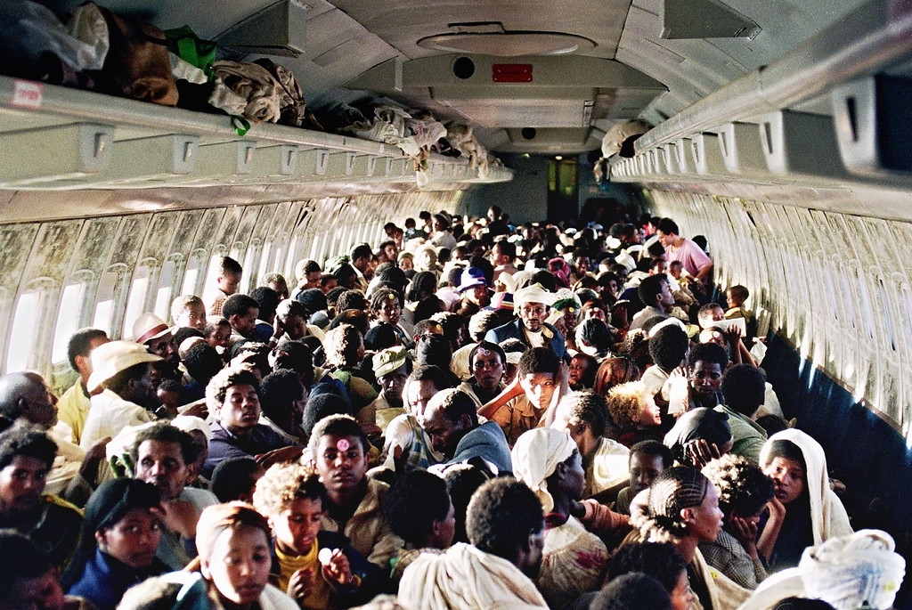 ". ON BOARD OF ISRAELI PLANE:Ethiopian Jews known as ""Falashas\"" sit on bard of an Israeli Air Force Boeing 707, during t heir transfer from Addis Ababa to Tel Aviv early 25 1991. Sixteen thousand five hundred \""Falashas\"" were evacuated from Ethiopia as part of \""Operation Solomon\"", the world\'s largest airlift carried out out by Israeli army. The large numbers of emigrants from Ethiopia and, primarily, from the Soviet Union, increased Israel\'s population by nearly 10 % in 3 years (between 1989-92). PATRICK BAZ/AFP/Getty Images"