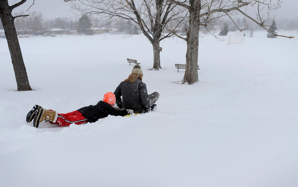 . Aidan Zerr, 8, left, and his brother Andrew Zerr, 15, sled down a hill on Feb. 24 in Littleton, Colo., and hope for a snow day tomorrow. Photo by Jamie Cotten, Special to The Denver Post