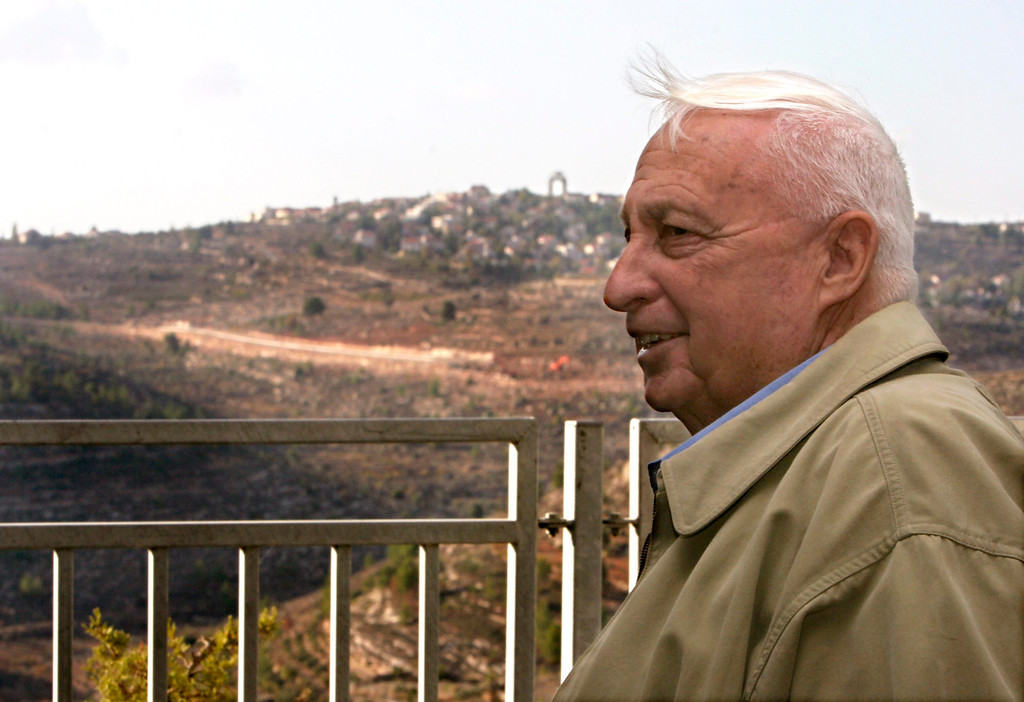 . A file photograph dated 08 November 2005 shows former Israeli Prime Minister Ariel Sharon on the outskirts of Mevessert Zion, to the West of Jerusalem, Israel, as he overlooks part of the \'separation fence\', or wall being constructed between here and Har Adar (in distance) near the Palestinian villages of Beit Surik and Beit Iksa.  EPA/JIM HOLLANDER