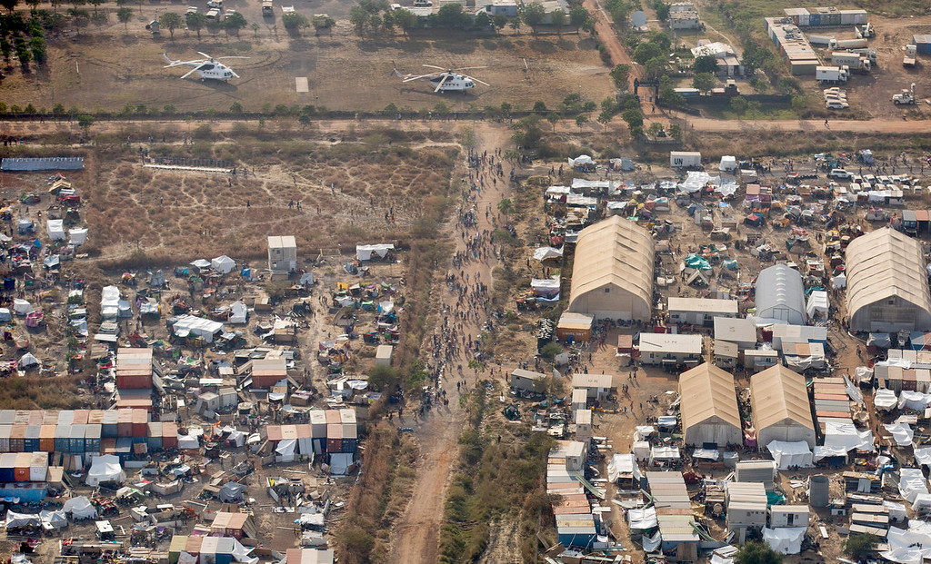 . A United Nations camp that has become home to the displaced living in makeshift tents is seen from an airplane over Malakal, South Sudan Monday, Dec. 30, 2013. When violence broke out in Juba on Dec. 15 life remained calm but tense in Malakal, the capital of oil-producing Upper Nile state, but the violence then radiated outward from Juba and full-fledged war broke out in the town on Christmas Day, as army commanders defected and pledged allegiance to the country\'s ousted vice president, in most cases pitting the ethnic group of President Salva Kiir, a Dinka, against ethnic Nuers. (AP Photo/Ben Curtis)