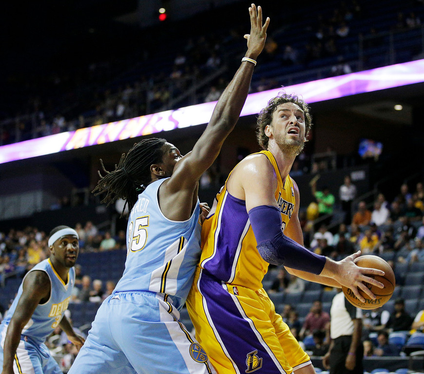. Los Angeles Lakers\' Pau Gasol, right, of Spain, looks for a shot against Denver Nuggets\' Kenneth Faried in the first half of an NBA preseason basketball game Tuesday, Oct. 8, 2013, in Ontario, Calif. (AP Photo/Jae C. Hong)
