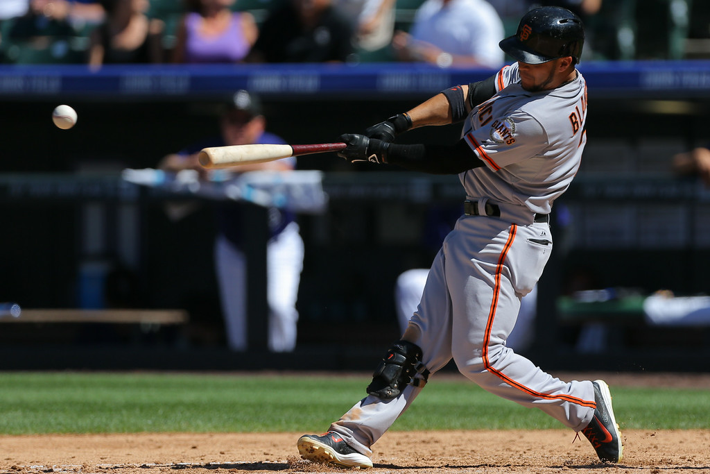 . DENVER, CO - SEPTEMBER 3:  Gregor Blanco #7 of the San Francisco Giants hits a triple during the fifth inning against the Colorado Rockies at Coors Field on September 3, 2014 in Denver, Colorado. (Photo by Justin Edmonds/Getty Images)