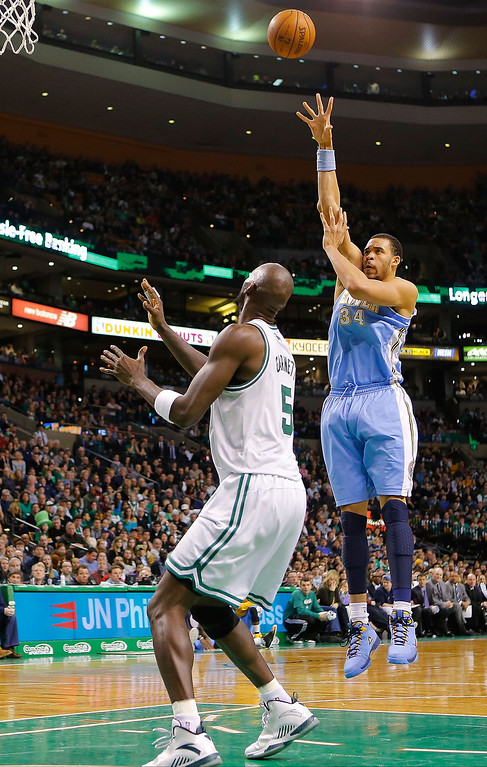 . BOSTON, MA - FEBRUARY 10: JaVale McGee #34 of the Denver Nuggets takes a shot over Kevin Garnett #5 of the Boston Celtics during the game on February 10, 2013 at TD Garden in Boston, Massachusetts.  (Photo by Jared Wickerham/Getty Images)