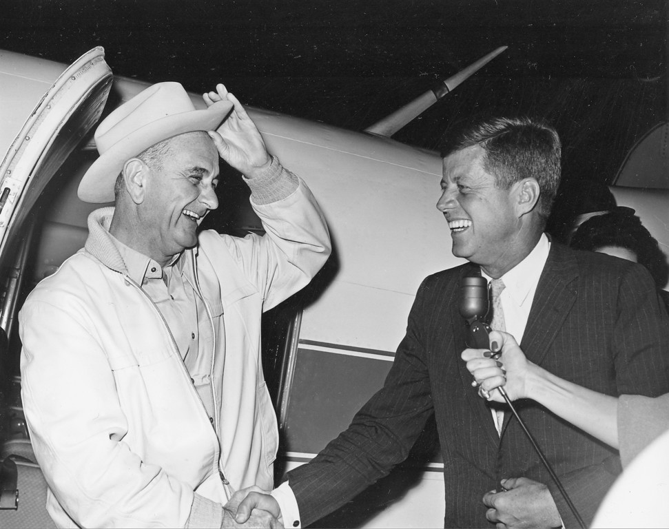 . Vice President-elect Johnson, greets Kennedy as the president-elect arrives at the LBJ ranch near Johnson City, Texas, on Nov. 16, 1960.  It was the first meeting for the pair since they won the election. Associated Press file