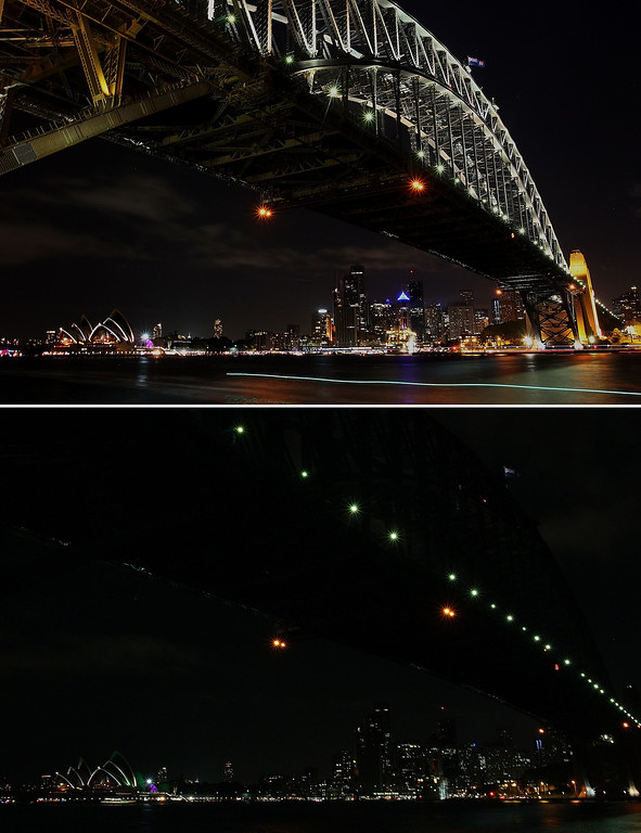 . In this composite image the Sydney Harbour Bridge is seen before on March 21 (top) and after the lights were switched off to recognize Earth Hour on March 23, 2013 in Sydney, Australia. Businesses and households around the world will turn their lights off for one hour at 20:30 local time today, to celebrate Earth Hour, raise awareness about climate change and to show support for the use of renewable energy. Earth hour began in Sydney in 2007 and is now celebrated in over 150 countries around the world.  (Photo by Lisa Maree Williams/Getty Images)