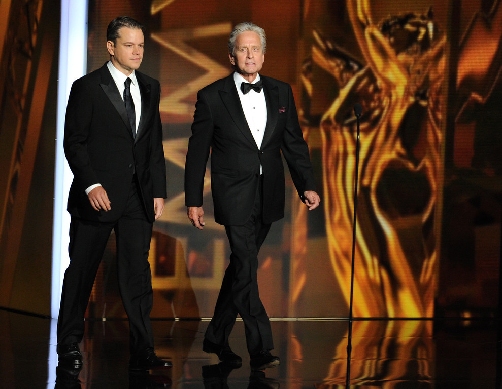 . Actors Matt Damon and Michael Douglas speak onstage during the 65th Annual Primetime Emmy Awards held at Nokia Theatre L.A. Live on September 22, 2013 in Los Angeles, California.  (Photo by Kevin Winter/Getty Images)