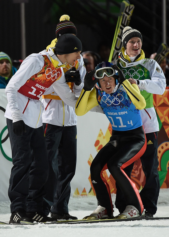 . Severin Freund of Germany celebrates with his team-mates after the Men\'s Team Ski Jumping final round on day 10 of the Sochi 2014 Winter Olympics at the RusSki Gorki Ski Jumping Center on February 17, 2014 in Sochi, Russia.  (Photo by Lars Baron/Getty Images)