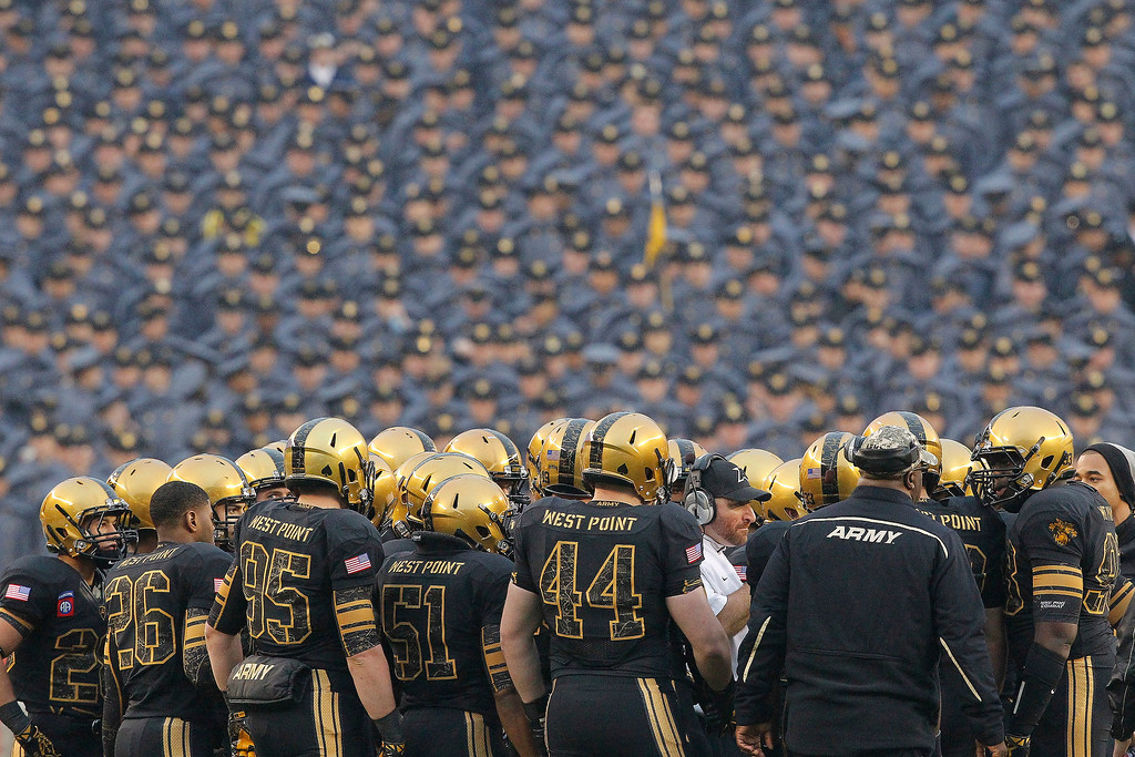 . Players of the Army Black Knights huddle during a time out during a game against the Navy Midshipmen on December 8, 2012 at Lincoln Financial Field in Philadelphia, Pennsylvania.  (Photo by Hunter Martin/Getty Images)