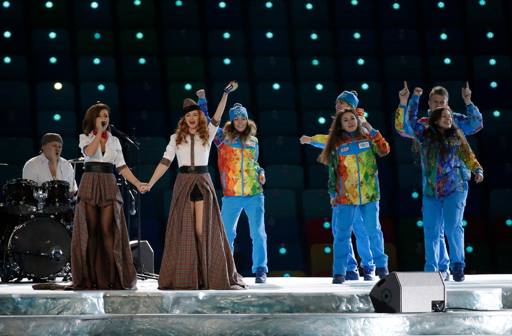 . Russian duo t.A.T.u. Lena Katina, third from left, and Yulia Volkova, second from left,  perform on stage before the opening ceremony of the 2014 Winter Olympics in Sochi, Russia, Friday, Feb. 7, 2014. (AP Photo/Mark Humphrey)