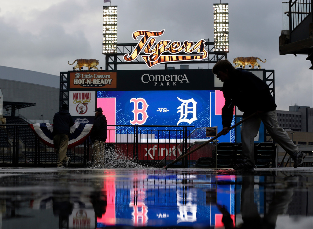 . Stadium employee Nick Link clears water on upper deck at Comerica Park before Game 5 of the American League baseball championship series between the Boston Red Sox and the Detroit Tigers, Thursday, Oct. 17, 2013, in Detroit. (AP Photo/Charlie Riedel)