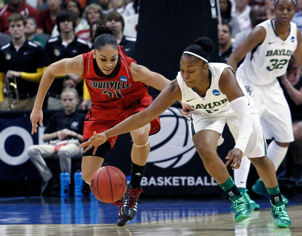 . Louisville guard Bria Smith, left, and Baylor guard Odyssey Sims, right, go after a loose ball during the second half of a regional semifinal game in the women\'s NCAA college basketball tournament in Oklahoma City, Sunday, March 31, 2013.  Louisville won 82-81.  (AP Photo/Alonzo Adams)