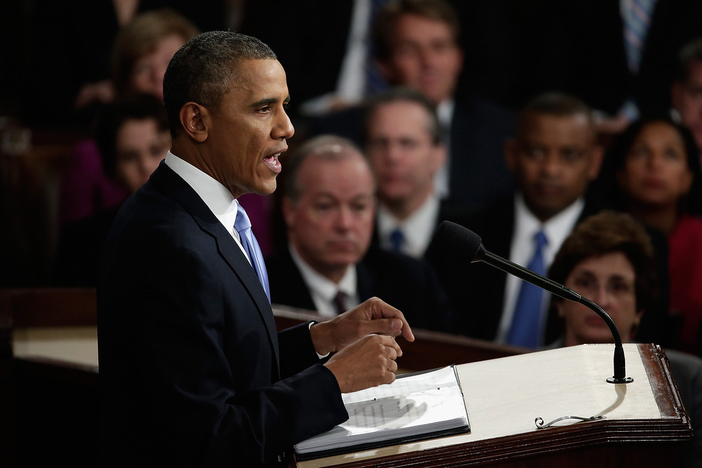 . WASHINGTON, DC - JANUARY 28:  U.S. President Barack Obama delivers the State of the Union address to a joint session of Congress in the House Chamber at the U.S. Capitol on January 28, 2014 in Washington, DC. In his fifth State of the Union address, Obama is expected to emphasize on healthcare, economic fairness and new initiatives designed to stimulate the U.S. economy with bipartisan cooperation.  (Photo by Win McNamee/Getty Images)