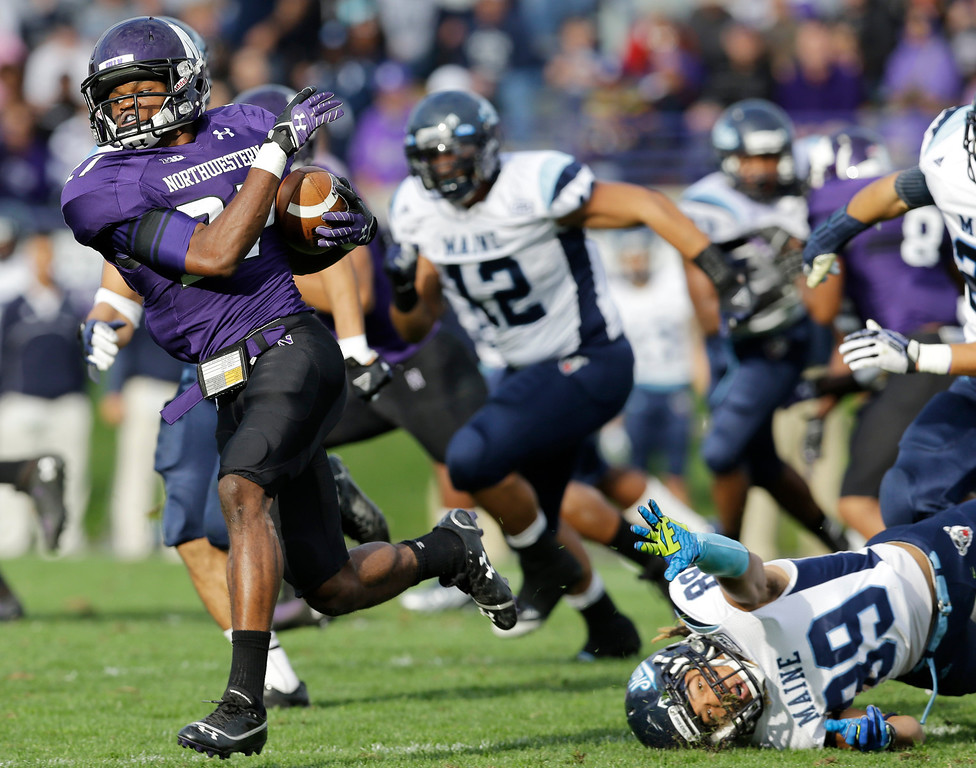 . Northwestern corner back Matthew Harris (27) runs with the ball past Maine wide receiver Arthur Williams (89) during the second half of an NCAA college football game in Evanston, Ill., Saturday, Sept. 21, 2013. Northwestern won 35-21. (AP Photo/Nam Y. Huh)
