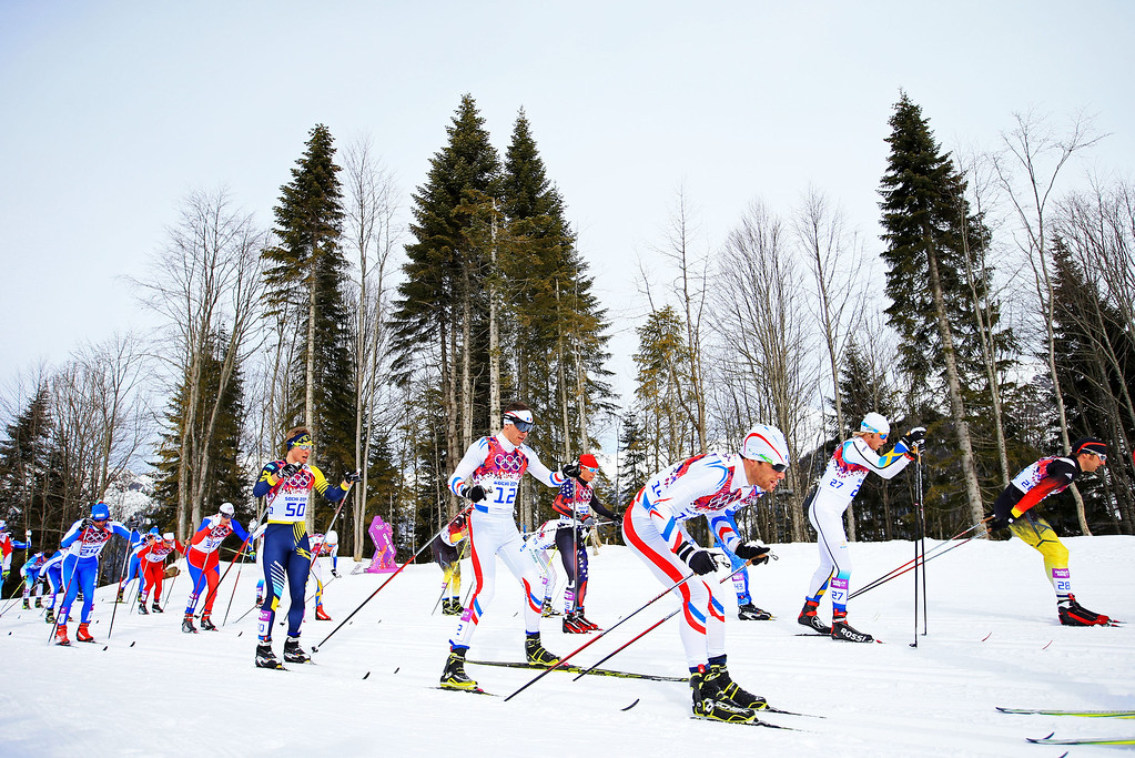 . SOCHI, RUSSIA - FEBRUARY 09:  Maurice Manificat (L) of France and Jean Marc Gaillard (R) of France compete in the Men\'s Skiathlon 15 km Classic + 15 km Free during day two of the Sochi 2014 Winter Olympics at Laura Cross-country Ski & Biathlon Center on February 9, 2014 in Sochi, Russia.  (Photo by Richard Heathcote/Getty Images)