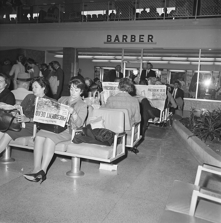 . People waiting for flights from Dallas at Love  Field read the news in the Dallas Times Herald on Nov. 23, 1963. Associated Press file