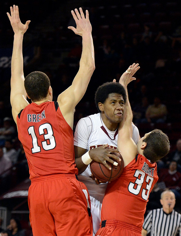 . DENVER, CO. - FEBRUARY 07: Royce O\'Neale (20) of the Denver Pioneers drives to the basket as he runs in to Luiz Bidart (33) of the Seattle Redhawks and Louis Green (13) during the first half February 7, 2013 at Magness Arena. Royce O\'Neale was called for offensive foul on the play. The Denver Pioneers take on the Seattle Redhawks in WAC competition. (Photo By John Leyba/The Denver Post)