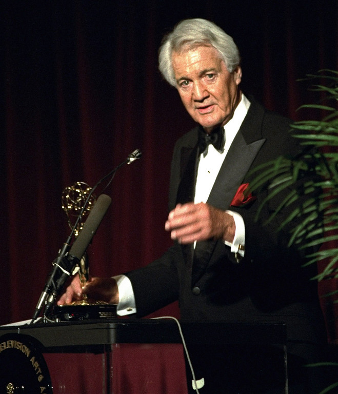 . FILE - In this April 19, 1994, file photo, Pat Summerall, completing his 34th and final season with CBS, receives an award for lifetime achievement at the 1994 Sports Emmy Awards in New York. Fox Sports spokesman Dan Bell said Tuesday, April 16, 2013, that Summerall, the NFL player-turned-broadcaster whose deep, resonant voice called games for more than 40 years, has died at the age of 82. (AP Photo/Rob Clark, File)