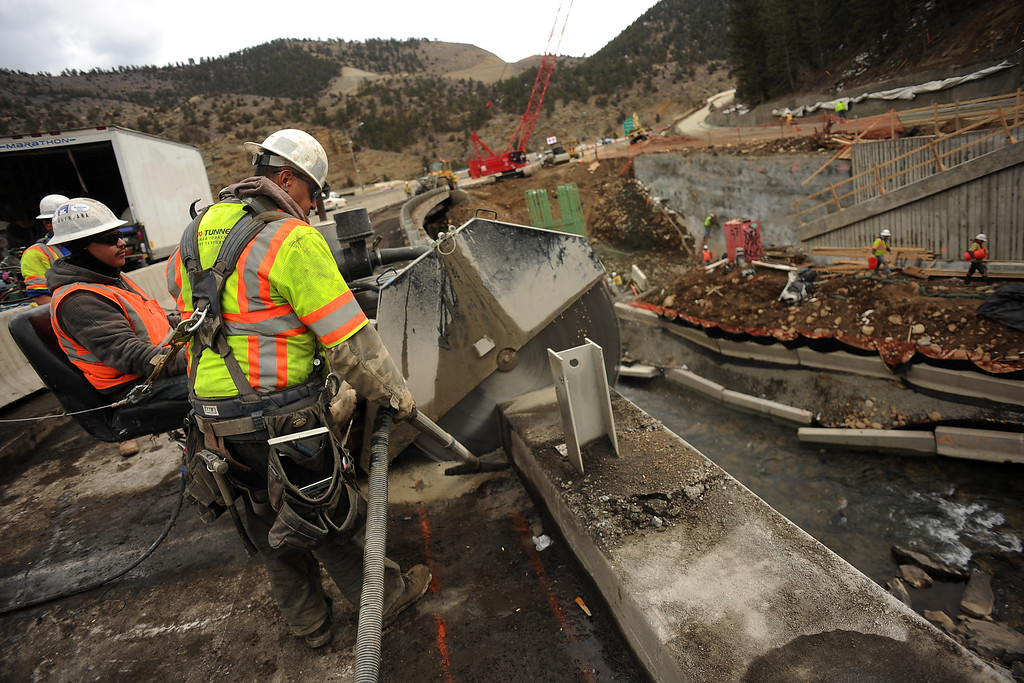 . IDAHO SPRINGS, CO- MARCH 28:  Construction workers use a concrete saw to cut into the old concrete on the bridge crossing Clear Creek.  This bridge will be dismantled and a new one with more lanes will be added.  This is just east of the twin tunnels. Construction continues on road work on I-70 and the twin tunnels near Idaho Springs on March 28th, 2013.  The highway is being widened in the east bound lanes.  The widening will start just west of the twin tunnels after Idaho Springs and will continue until the exit for Highway 6 where I-70 becomes three lanes.  They expect the project to be finished by the end of 2013.  (Photo By Helen H. Richardson/ The Denver Post)