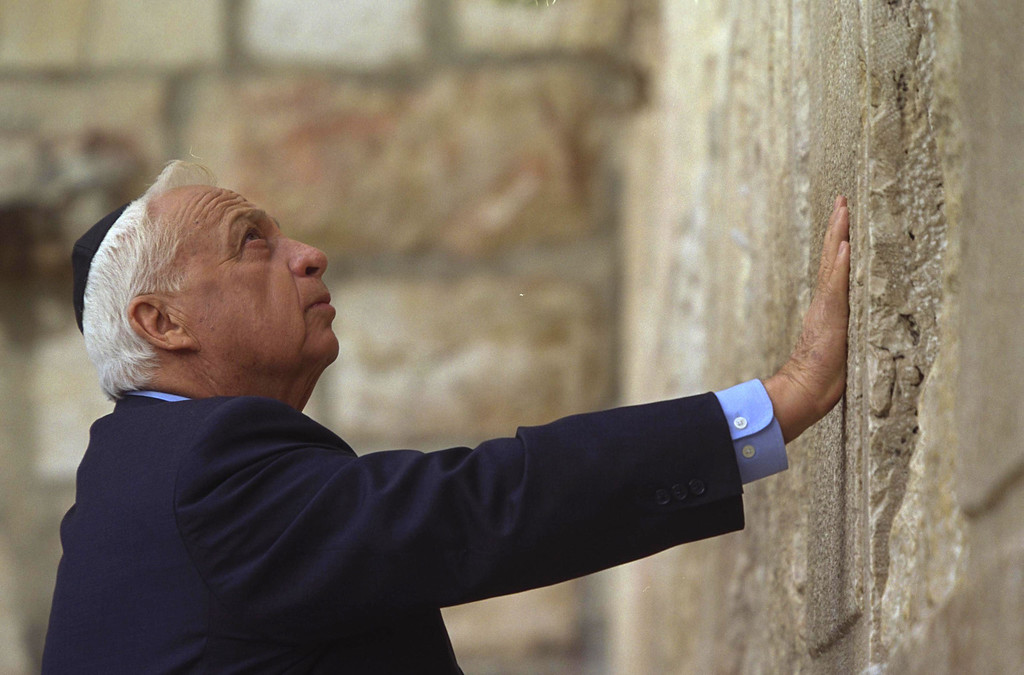 . In this handout provided by the Israeli Governmental Press Office, Israeli Prime Minister elect Ariel Sharon prays the day after his election victory at the Western Wall, Judaism\'s holiest site, February 7, 2001 in Jerusalem\'s Old City. (Photo by Avi Ohayon/GPO via Getty Images)