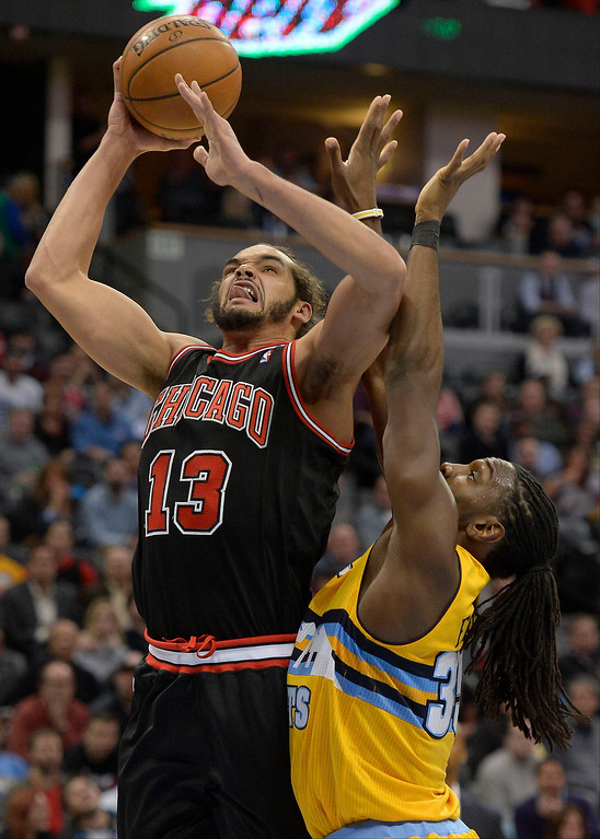 . Chicago Bulls center Joakim Noah (13) goes up for a shot on Denver Nuggets power forward Kenneth Faried (35) during the third quarter November 21, 2013 at Pepsi Center. (Photo by John Leyba/The Denver Post)