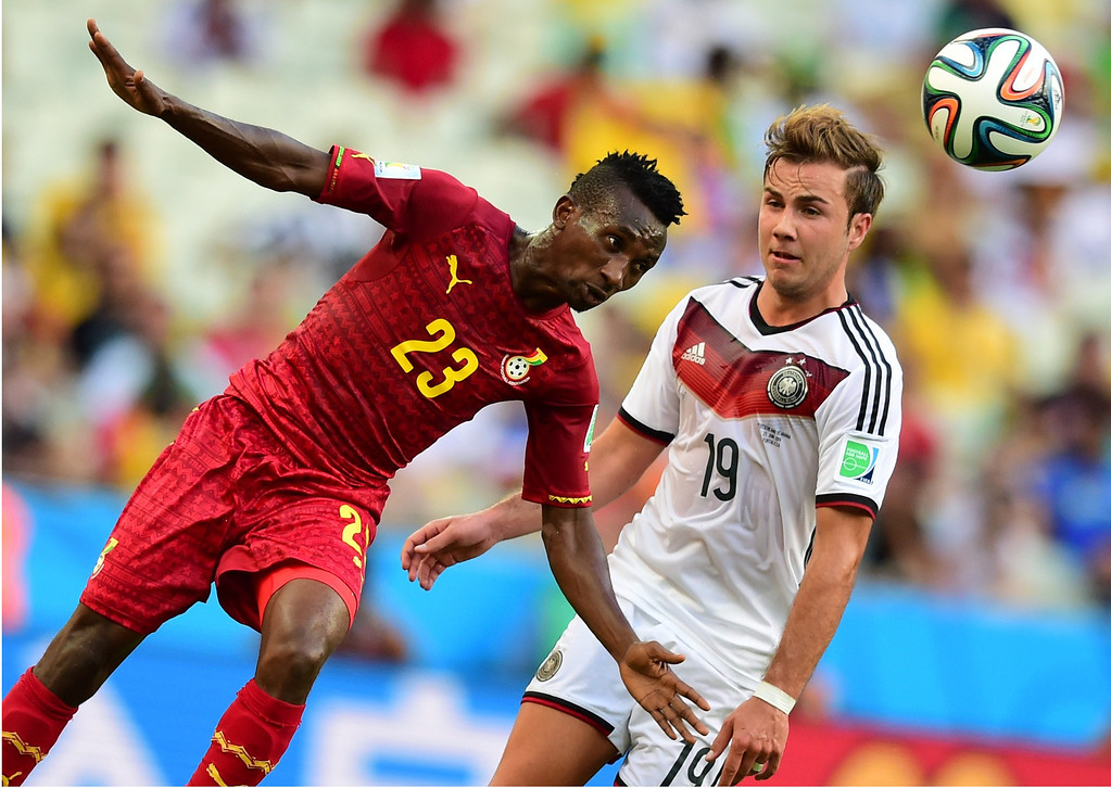 . Ghana\'s defender Harrison Afful (L) vies with Germany\'s forward Mario Goetze during a Group G football match between Germany and Ghana at the Castelao Stadium in Fortaleza during the 2014 FIFA World Cup on June 21, 2014.  JAVIER SORIANO/AFP/Getty Images