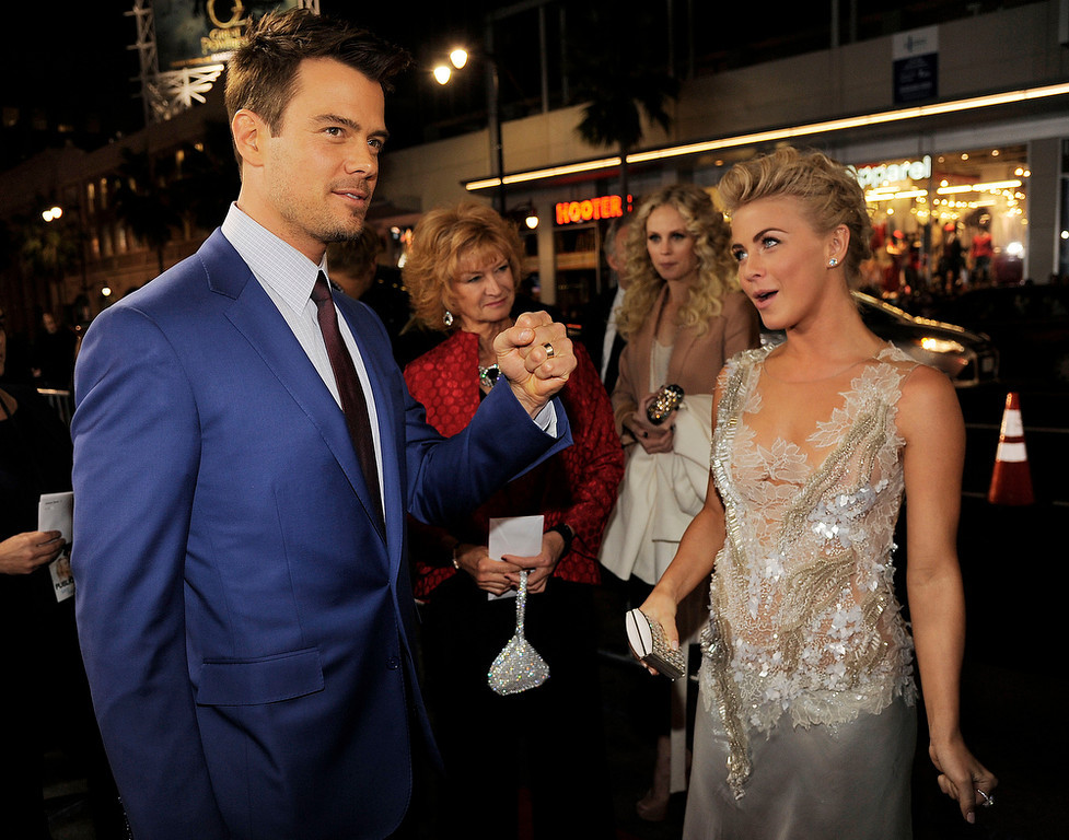 """. Josh Duhamel, left, and Julianne Hough, cast members in \""""Safe Haven,\"""" greet each other at the U.S. premiere of the film, Tuesday, Feb. 5, 2013, in the Hollywood section of Los Angeles. (Photo by Chris Pizzello/Invision/AP)"""