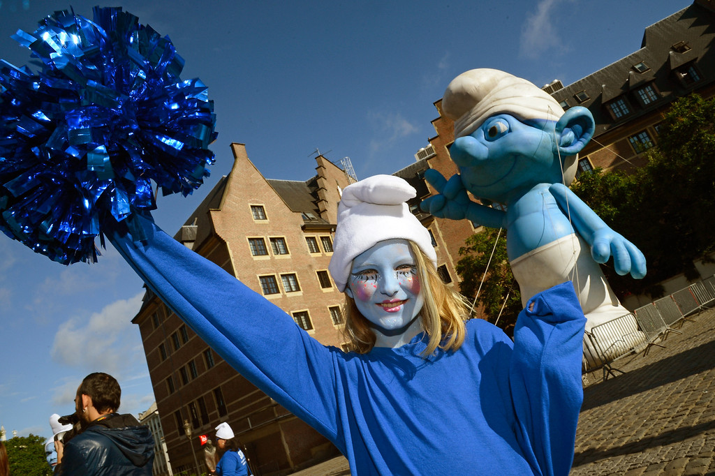 . Nina Guerin Culliford, the granddaughter of cartoonist Peyo, the creator of The Smurfs, poses by a giant Smurf character during Global Smurfs Day celebrations on June 22, 2013 in Brussels, Belgium.  (Photo by Pascal Le Segretain/Getty Images for Sony Pictures Entertainment)